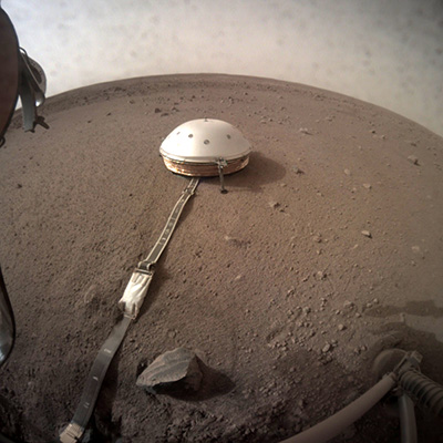 The WTS's positioning over SEIS during sol 66 kicked off the seismometer's commissioning phase, starting with measurements of thermal stability under the dome (© NASA/JPL-Caltech).