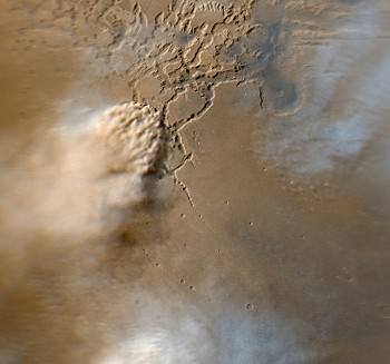 Orbital view of a dust storm near the huge Valles Marineris canyon (© NASA).